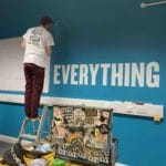 Hand painting office motivational quote mural