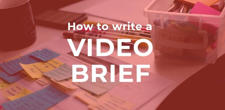 """image of pens, paper and post its with text """"how to write a video brief"""" overlaid"""